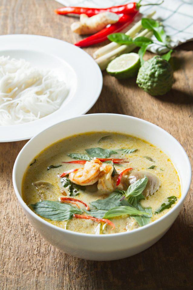Green curry with shrimp and rice noodles. Thai cuisine.