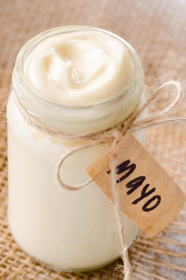 Jar of mayo with label on hessian, a salad dressing or sandwich condiment