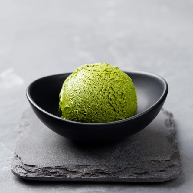Green tea matcha ice cream scoop in bowl