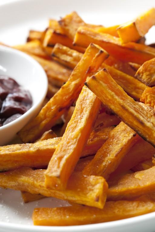 Stock zoete aardappel friet