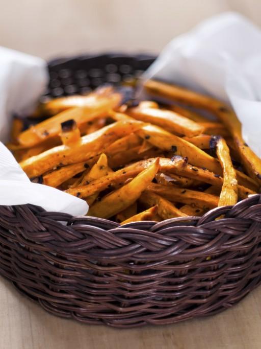 Zoete aardappel friet stock