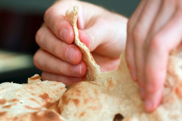 Flat bread handen stock