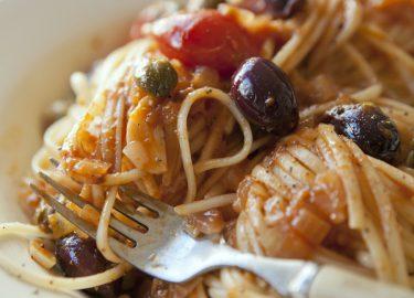 Pasta puttanesca spaghetti stock