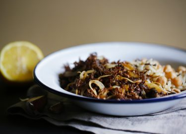 Pulled beef meat with wild rice and chickpeas, cuban cuisine