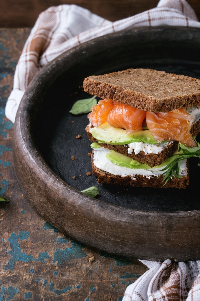 Stock Avocado, salmon and ricotta sandwich
