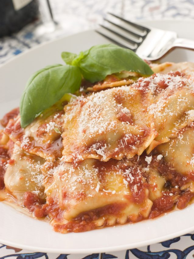 Plate of Veal and Sage Ravioli with Tomato and Basil Sauce with Grated Parmesan