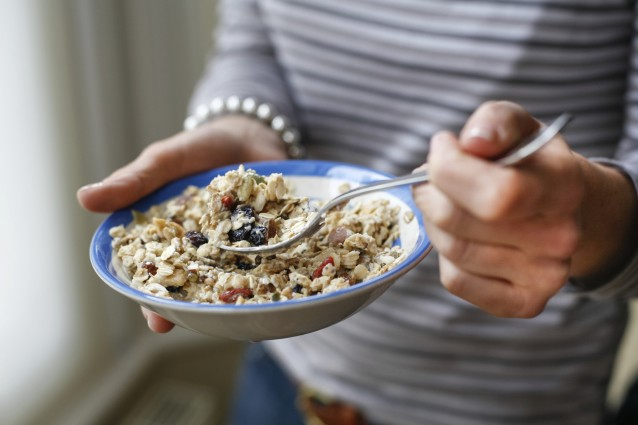 woman's hands holding muesli
