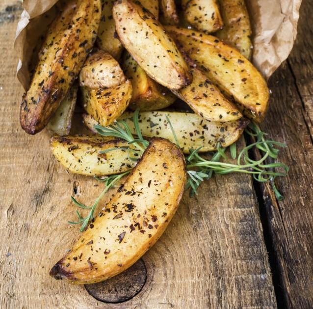 Gebakken aardappeltjes stock