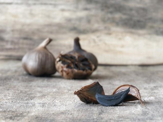 Fermented black garlic bulbs and cloves