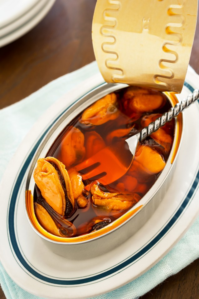 Fork Inside Canned Mussels in Escabeche