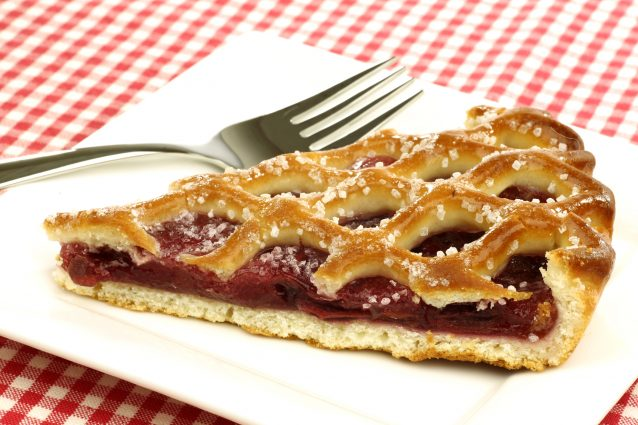 "Limburgse vlaai slice of decorated cherry pie called ""vlaai"" in Holland"