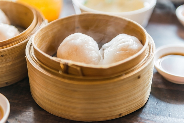 chinese steamed shrimp dimsum in bamboo containers with soy sauce