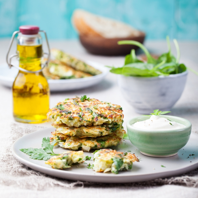 Cabbage and spinach pancakes with yogurt dressing with fresh herbs
