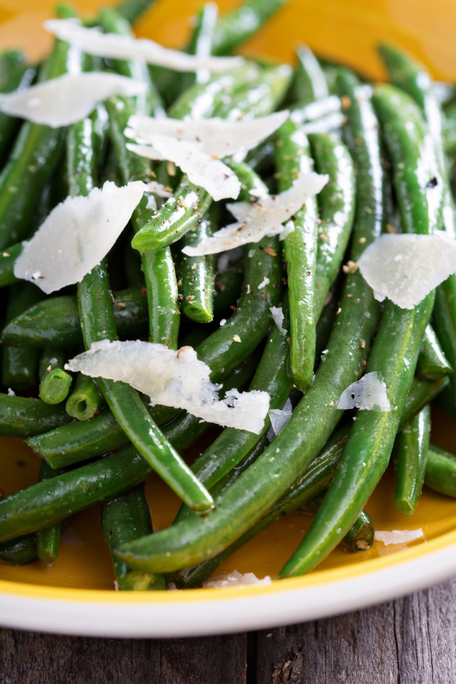 Sauteed green beans with parmesan cheese on big plate