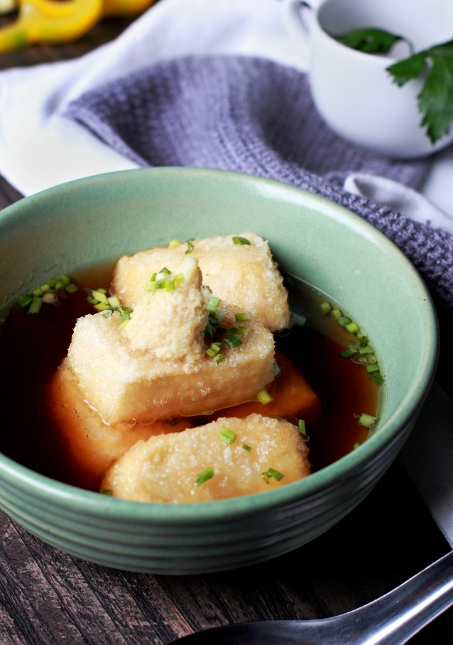 close up portrait of japanese cuisine agedashi tofu served on green bowl