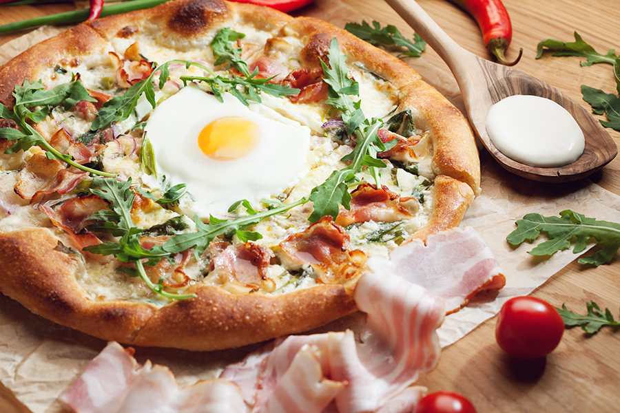 Kan best: een eitje op je pizza