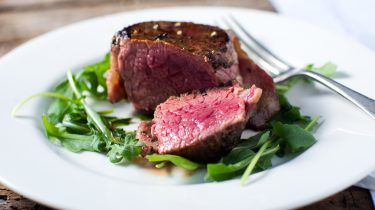 Beef steak filet mignon cut seared cooked rare